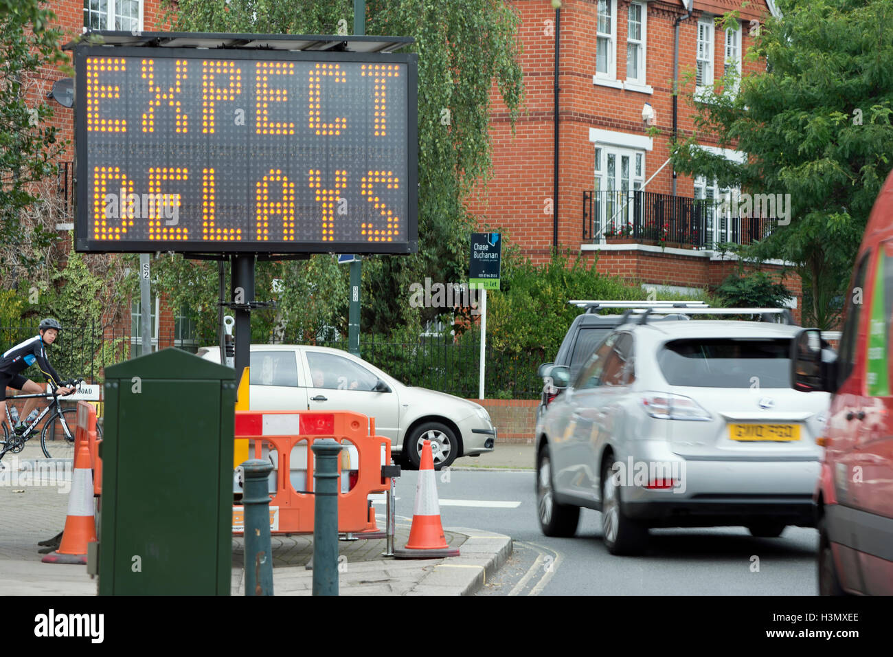 temporary expect delays sign at a road junction in twickenham, middlesex, england - Stock Image