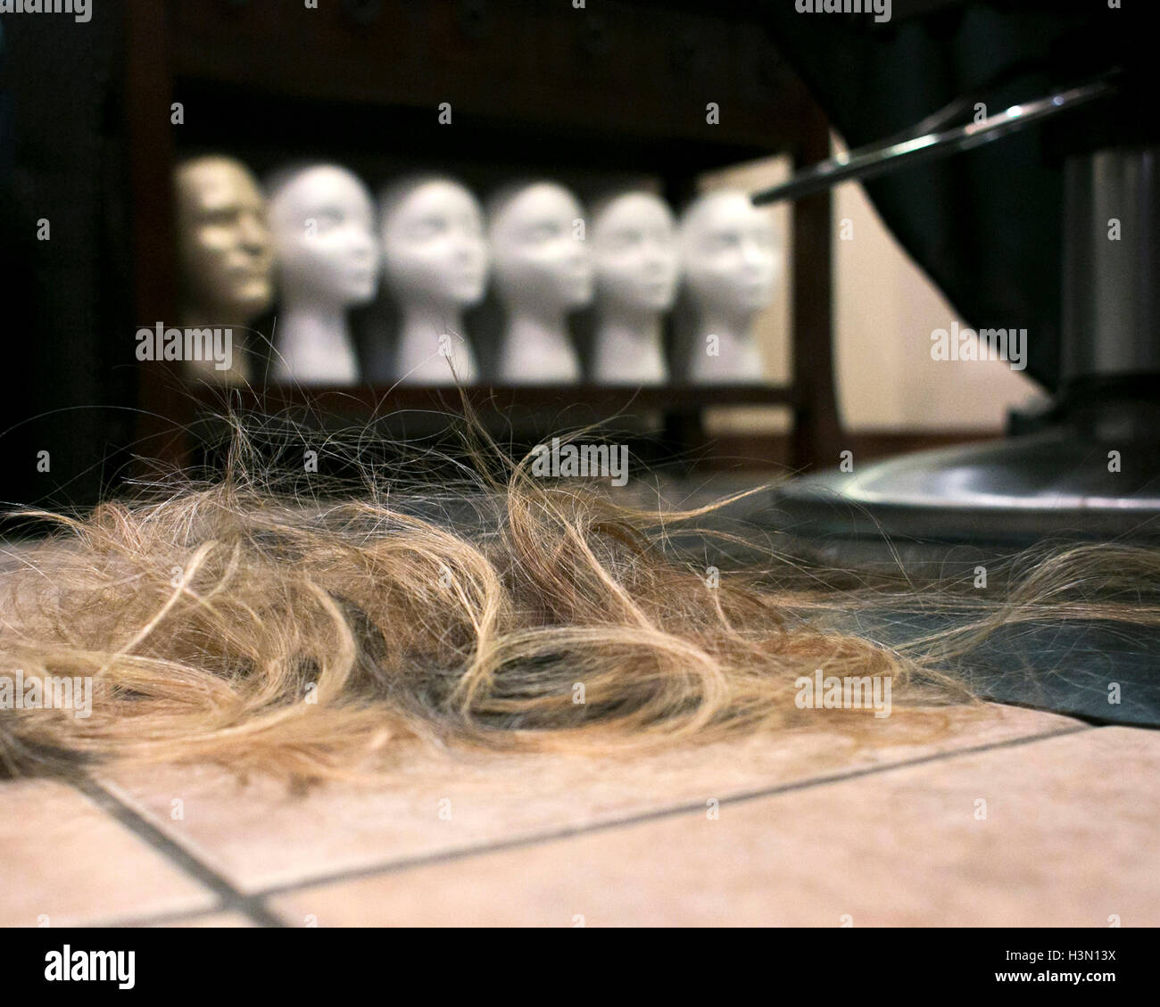 Hair clippings at a salon - Stock Image
