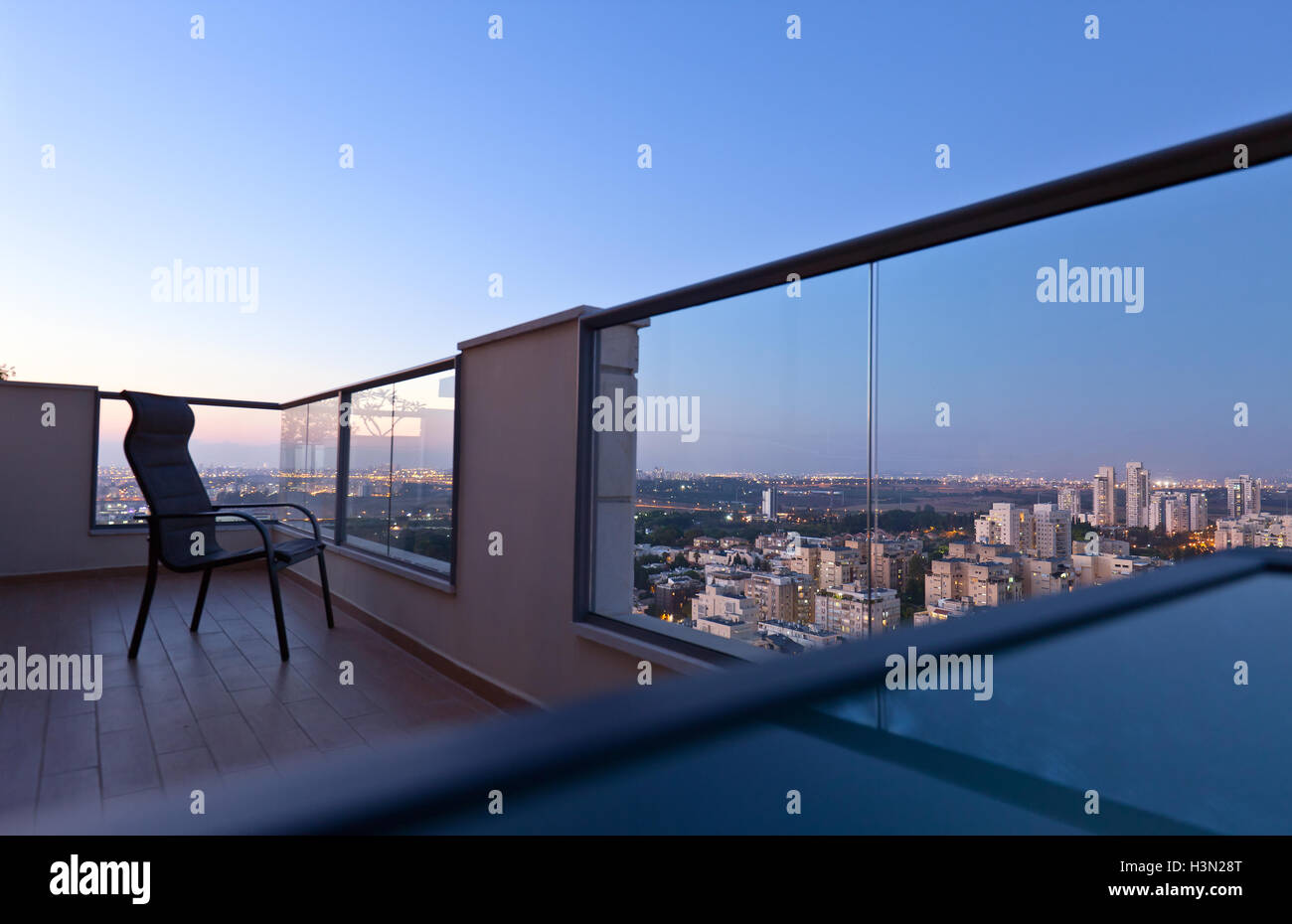 High end balcony in downtown of modern city - Stock Image