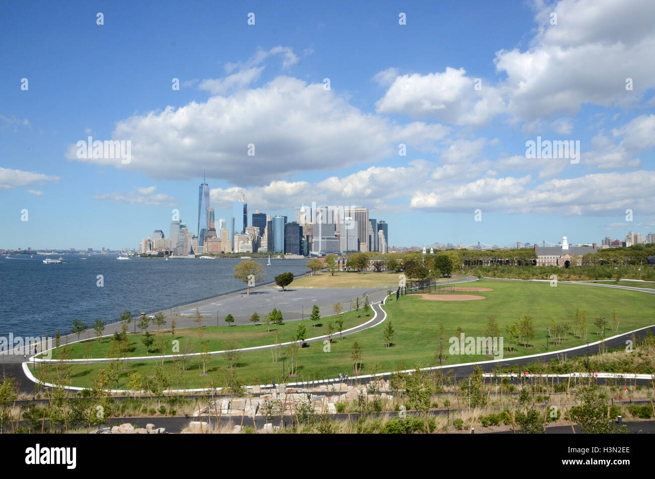 View of Manhattan seen across landscaped fields on Governor's Island, New York - Stock Image