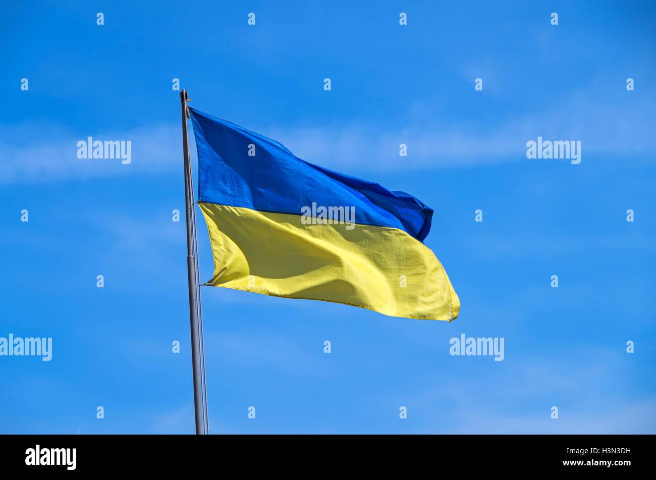 Ukrainian flag flying on a flagpole in motorized infantry military unit - Stock Image