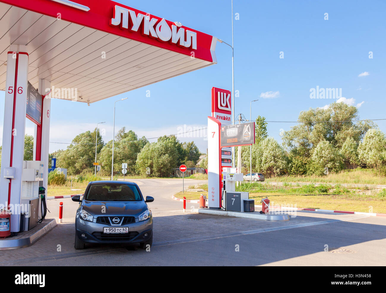 Car Nissan Qashqai at the Lukoil gas station - Stock Image
