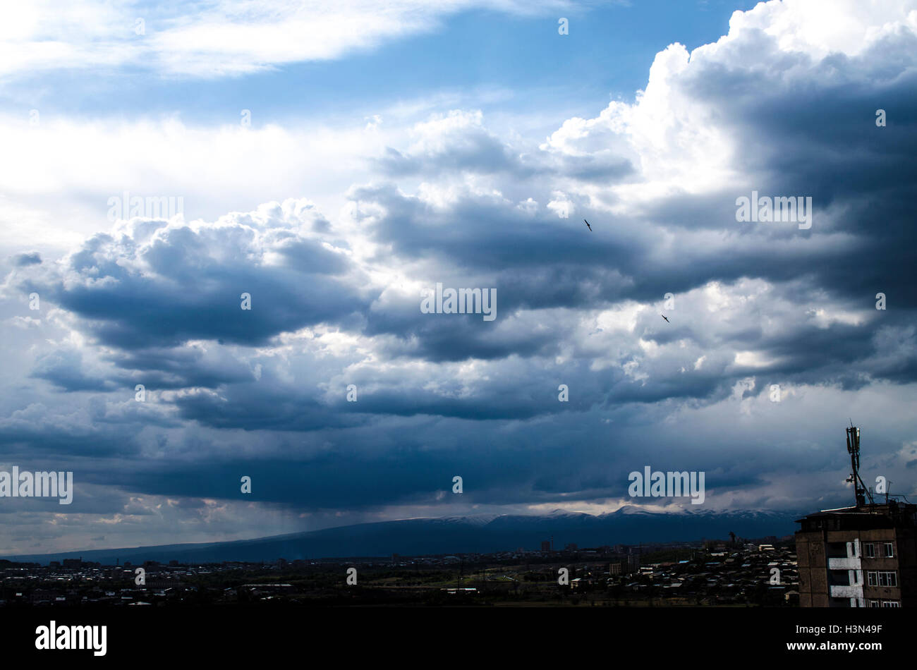 Stormy clouds before a rain around the city - Stock Image