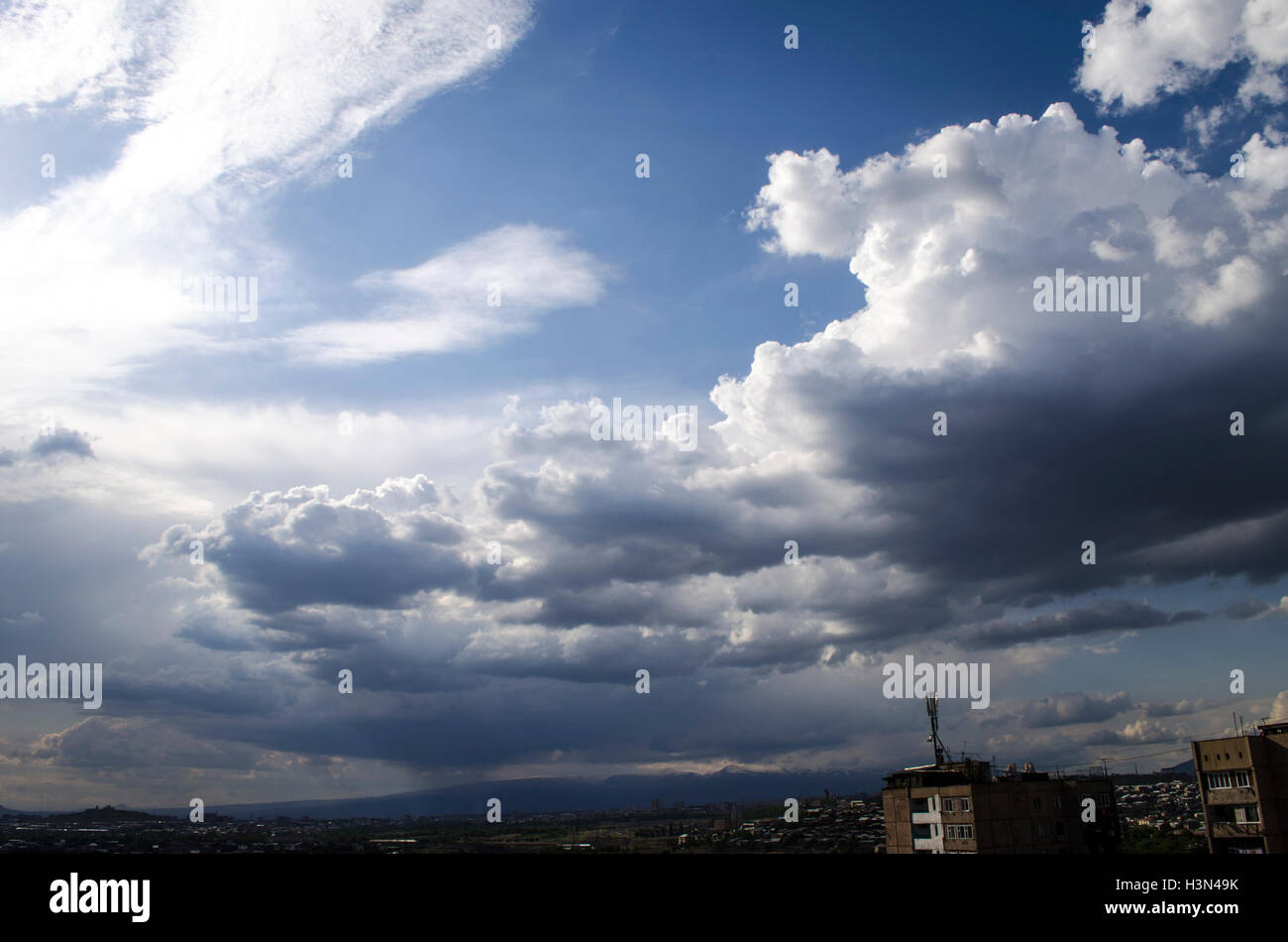 Dark rainy clouds all over the city - Stock Image