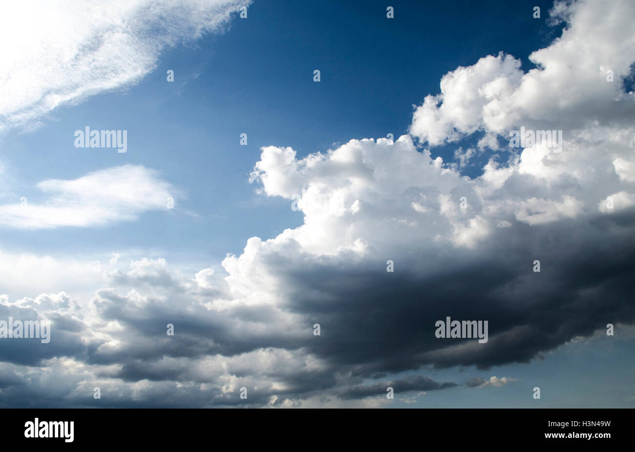 Dark clouds before a hurricane on a clear sunny day - Stock Image