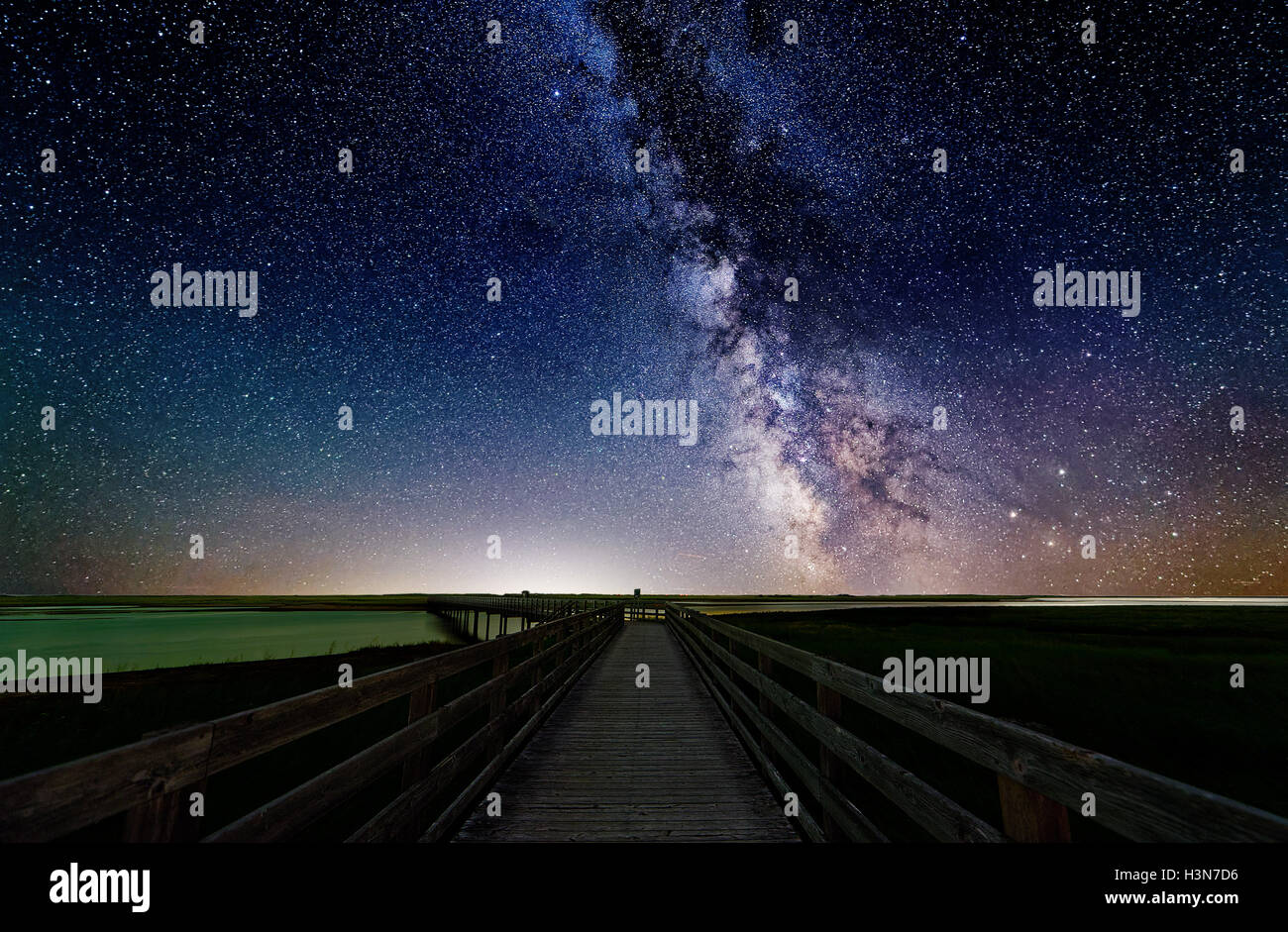 Kellys Beach Walkway and the Milky Way in dark skies in Kouchibouguac National Park in New Brunswick, Canada - Stock Image