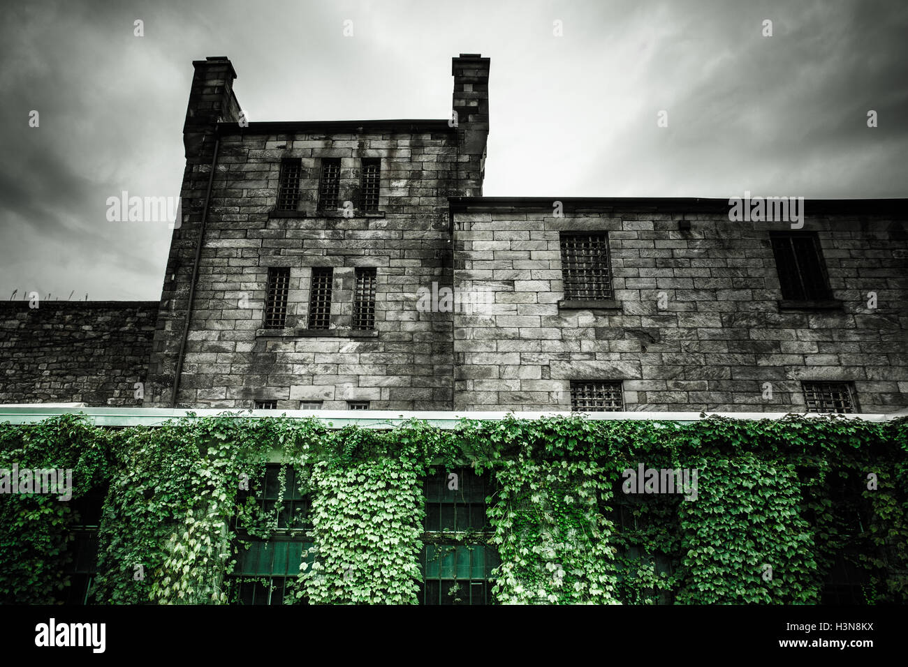 Ominous exterior view of Eastern State Penitentiary in Philadelphia PA - Stock Image