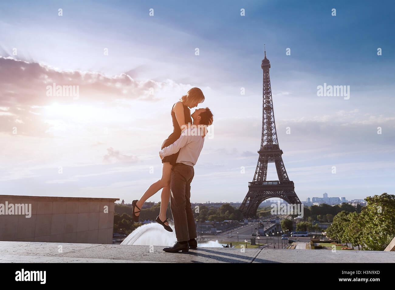 Cheerful romantic couple at trocadero near eiffel tower - Stock Image