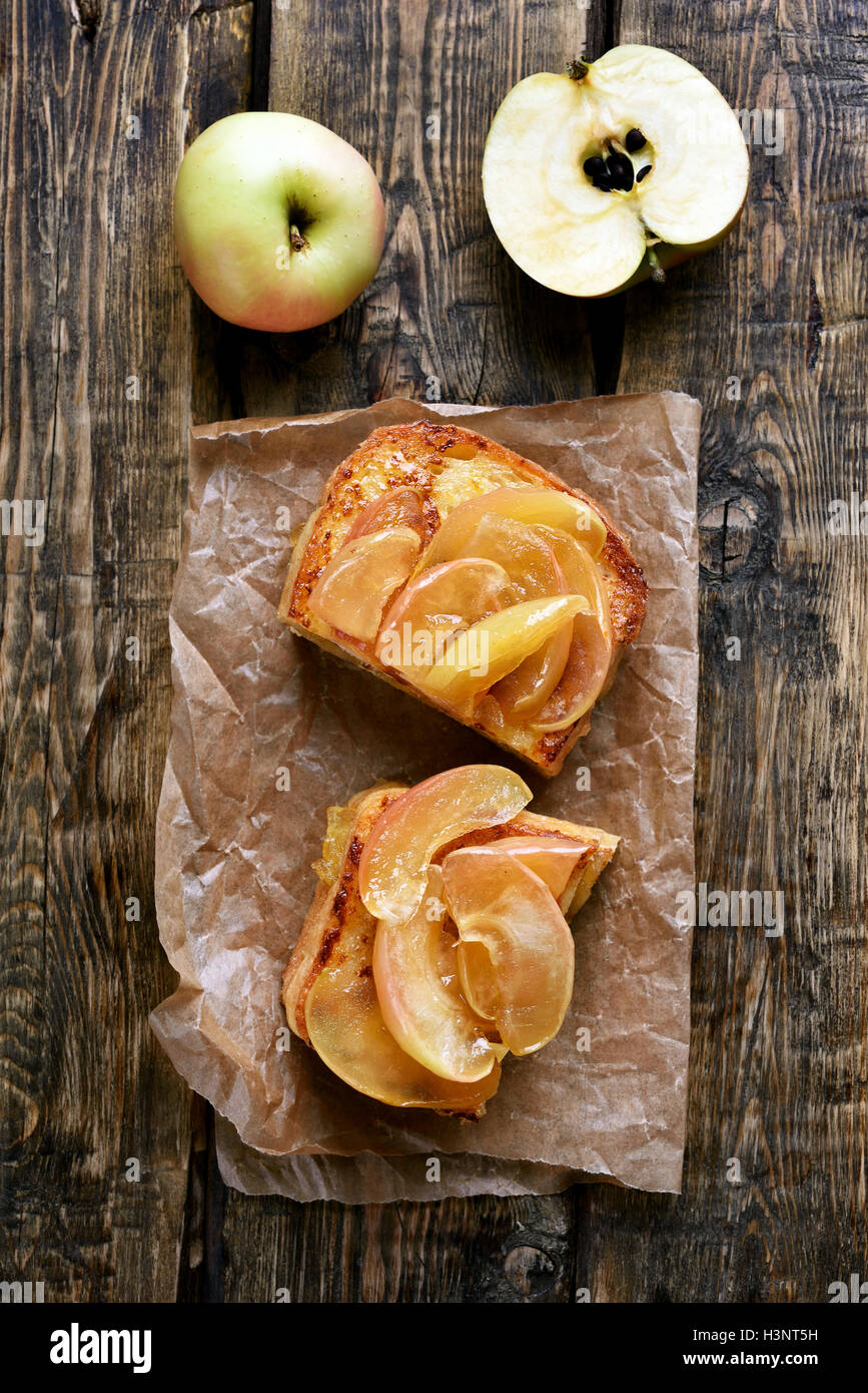 Caramelized apples on toast bread, top view - Stock Image