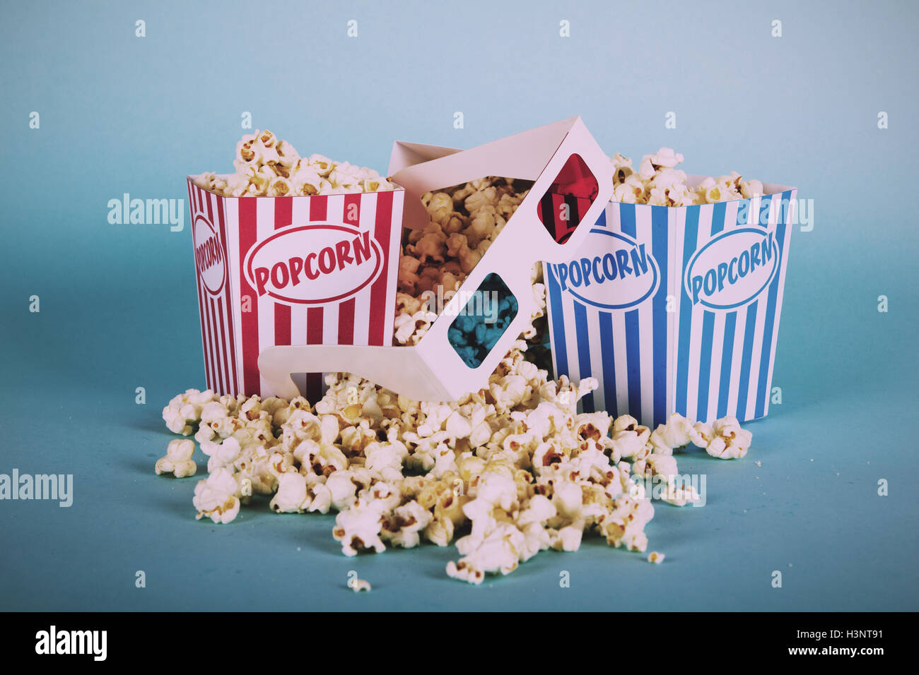 Bucket Of Popcorn Against A Blue Background Vintage Retro Filter Stock Photo Alamy