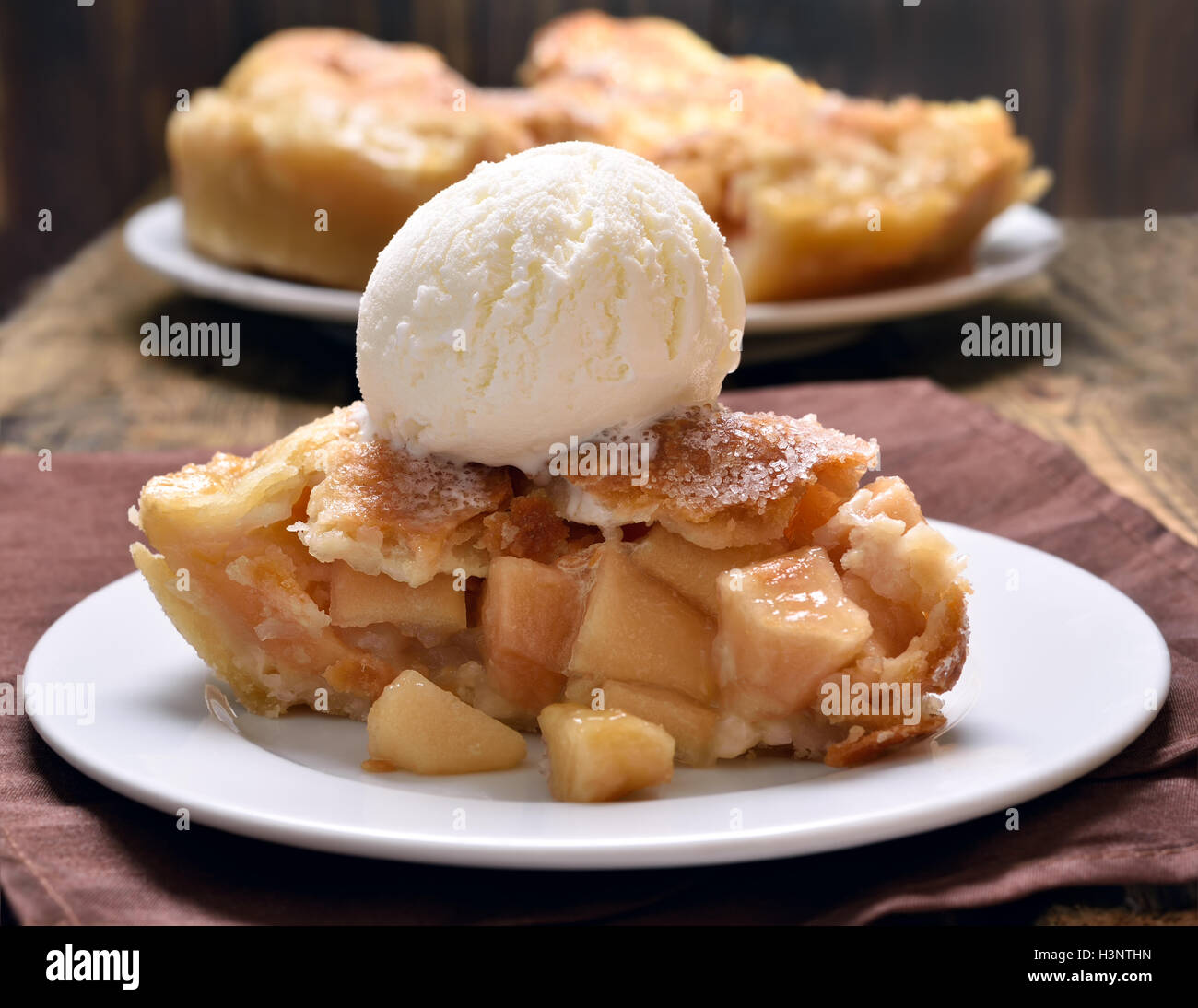 Piece of apple pie served with ice cream, close up view - Stock Image