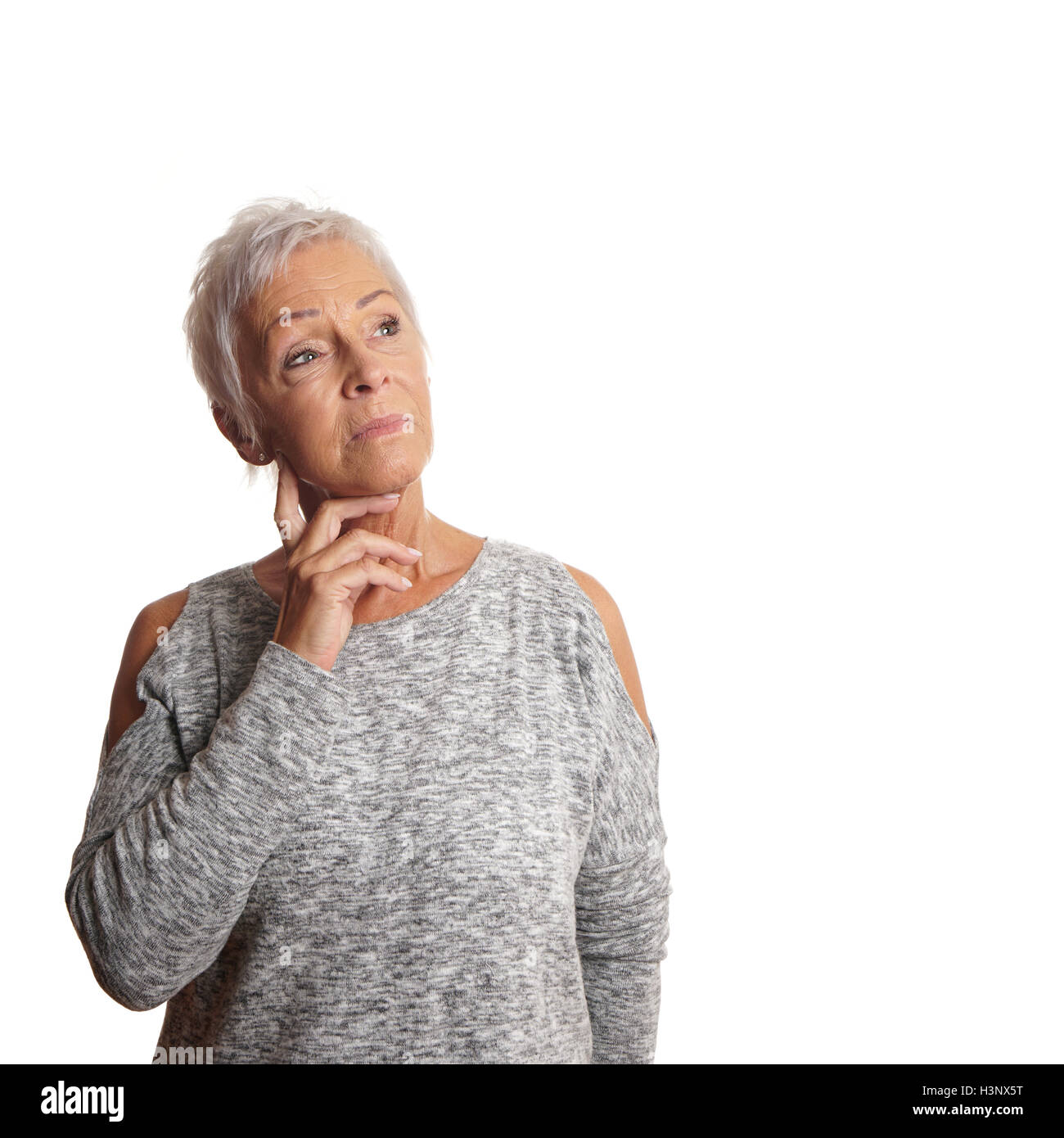concerned mature woman looking up - Stock Image