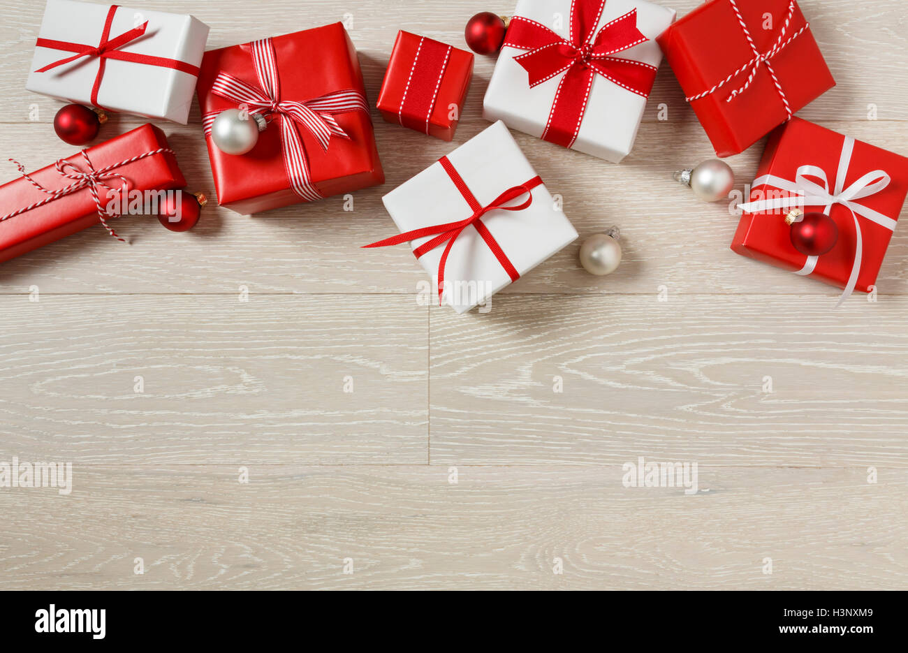 Christmas gifts presents on rustic wood background. Red and white ...