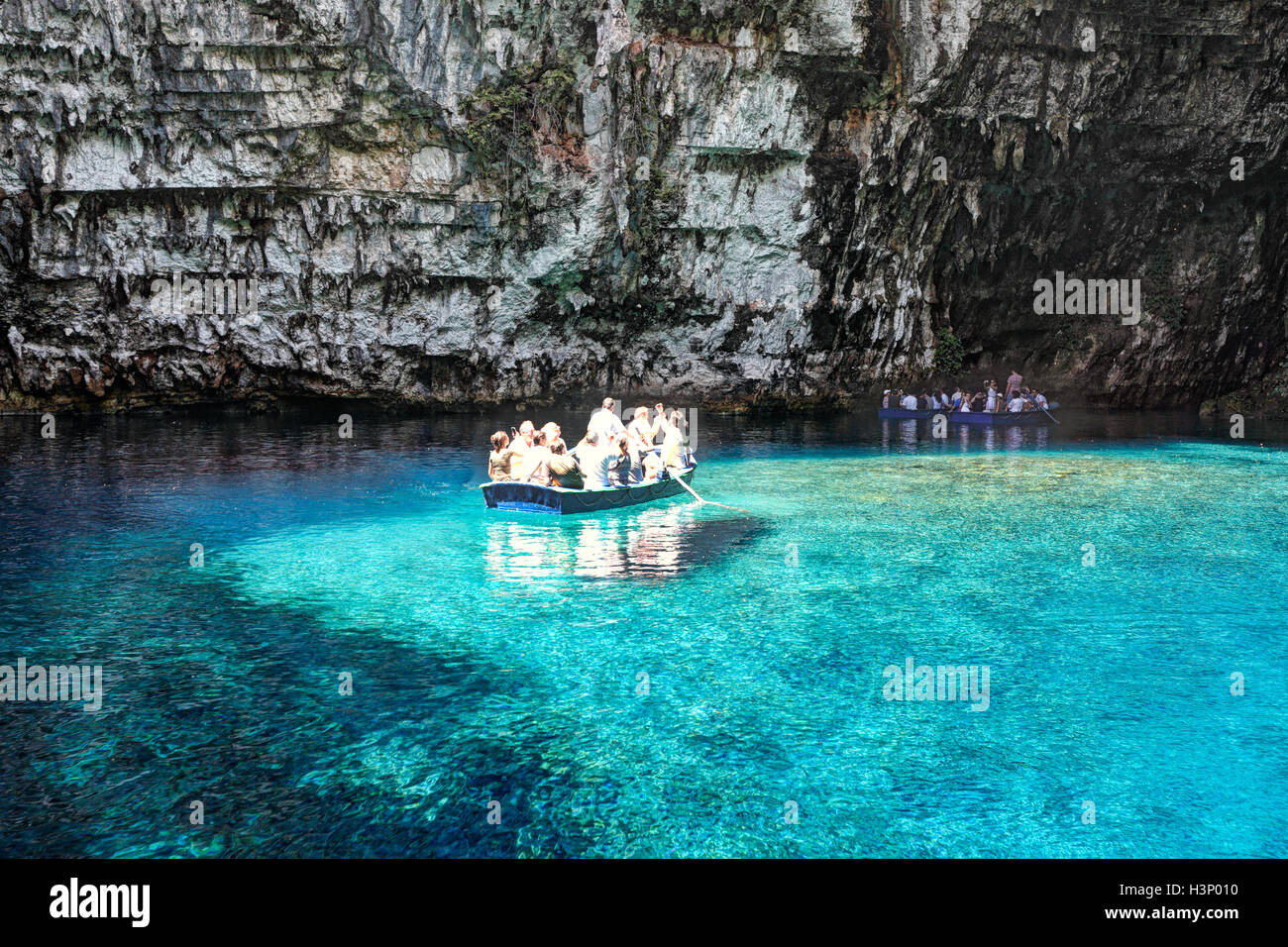 The tour in the cave of Melissani lake in Kefalonia island, Greece - Stock Image