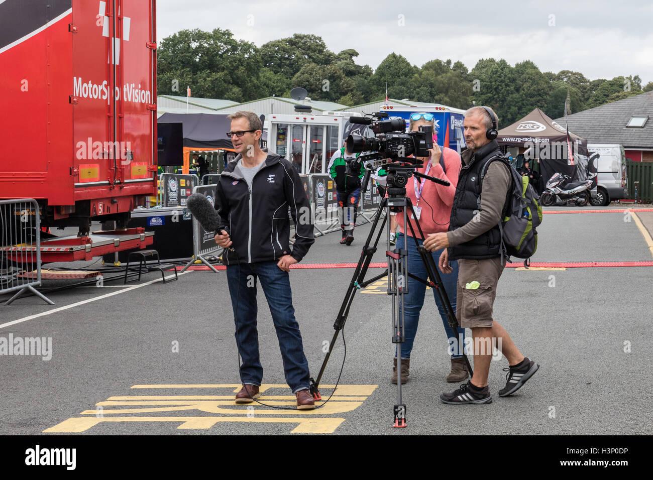 Eurosport commentator James 'Jamie' Whitham covering MCE British Superbike Championship race at Oulton Park, - Stock Image