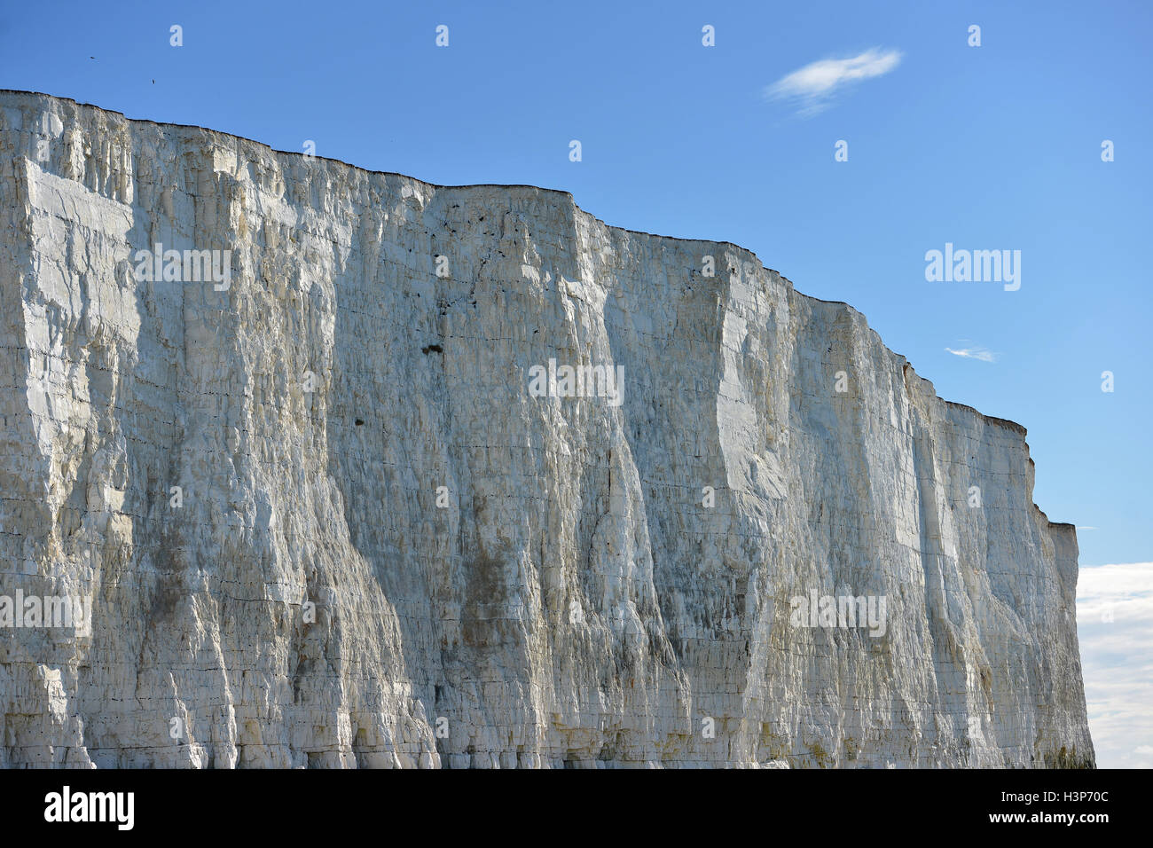 White chalk cliffs near Beachy Head, Eastbourne and rock pools - Stock Image