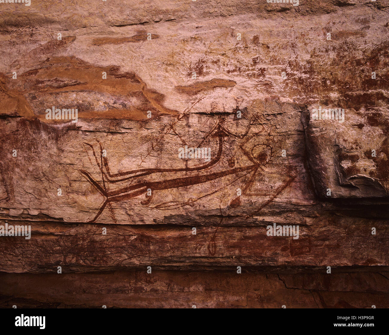 Aboriginal rock art: reclining couple. - Stock Image