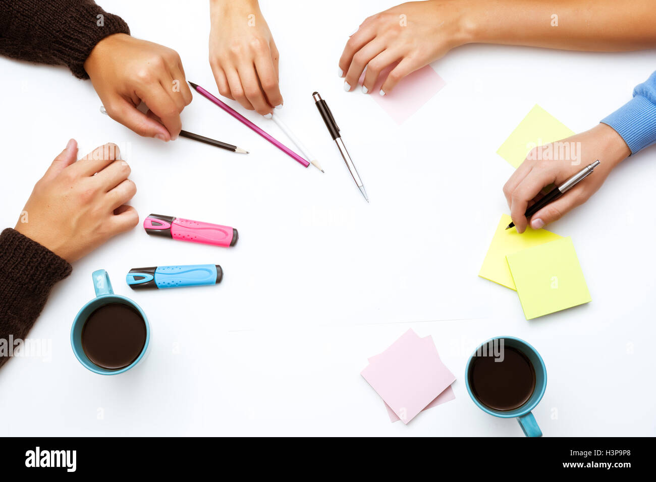 Group of people hands table work space concept - Stock Image