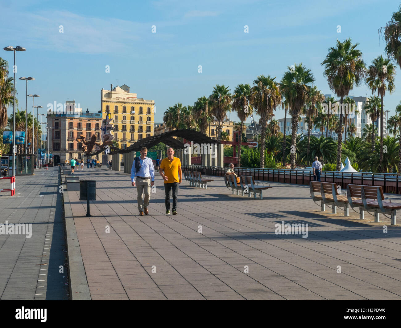 BARCELONA, SPAIN - OCT 5: passersby on a sunny day on October 5, 2016, on the Walk 'Moll de la Fusta', on - Stock Image