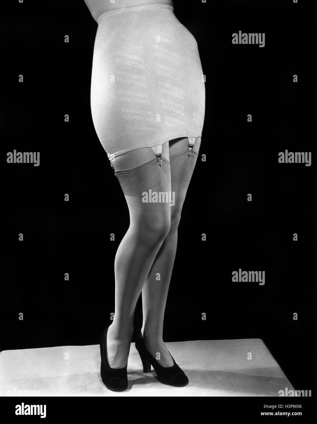 Women modeling girdles