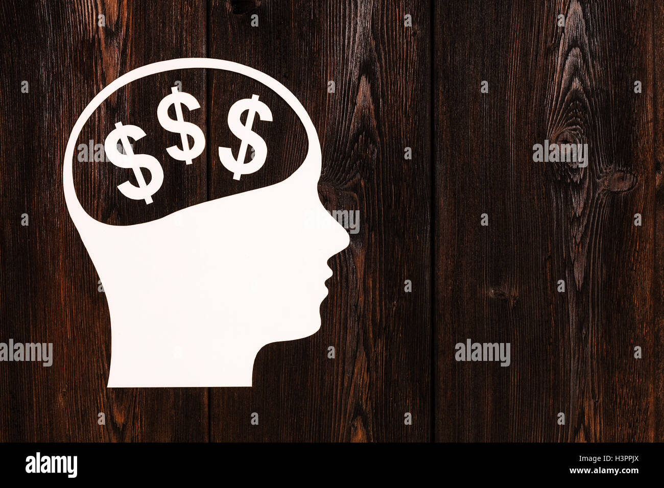 Paper head with dollar signs. Abstract conceptual image - Stock Image