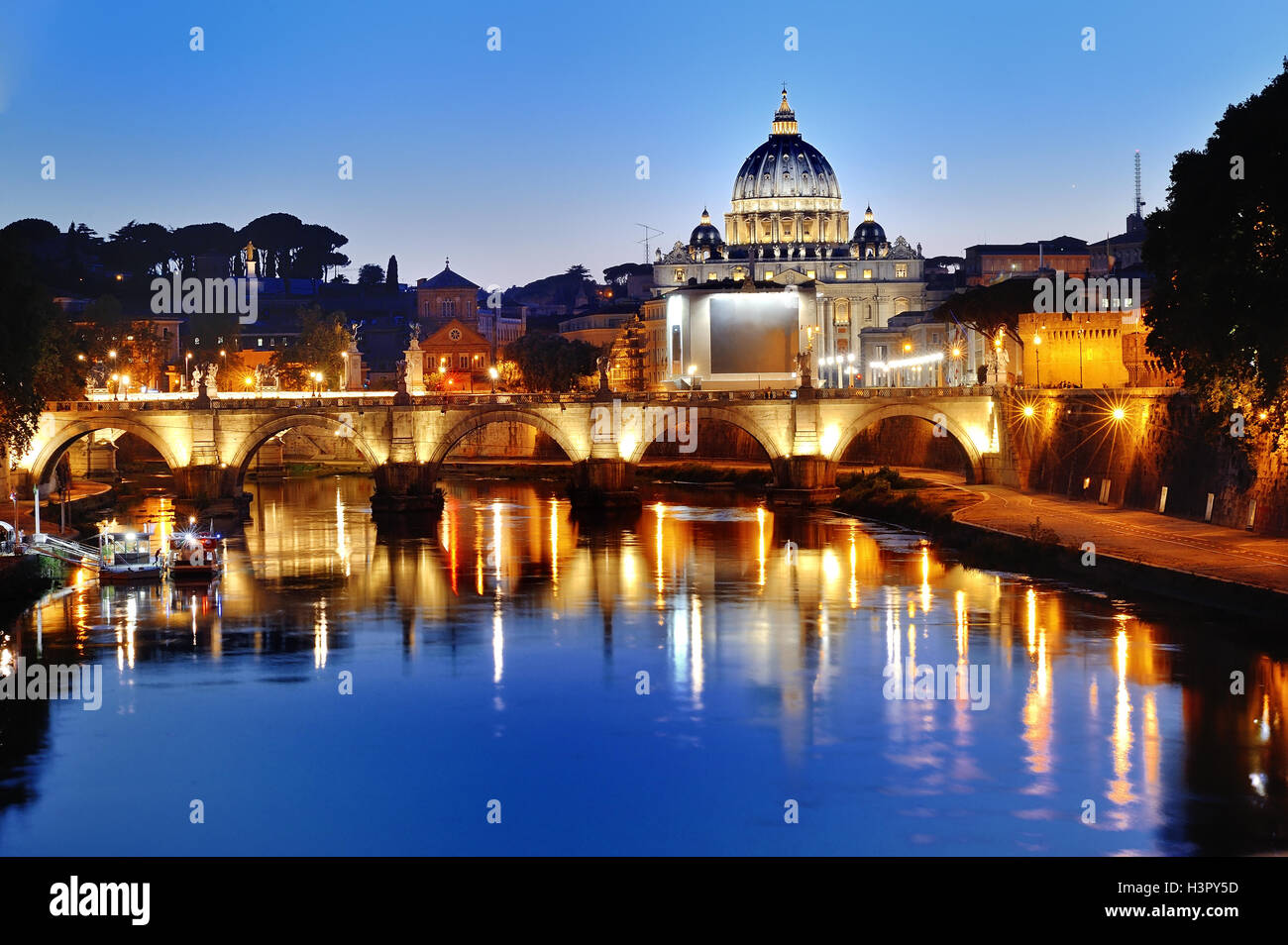 Rome, Italy - scenic view of the Tiber river and St. Peter's Basilica at night - Stock Image