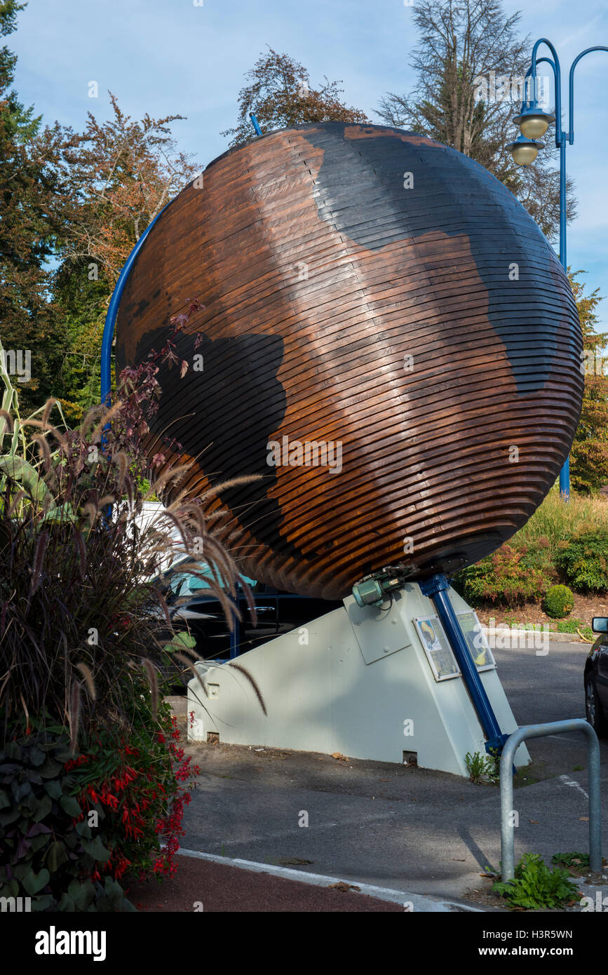 Wooden globe sculpture at the casino, Divonne les bains,  Ain department in eastern France - Stock Image