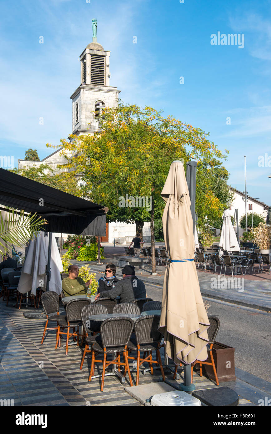 People sitting in street cafe, Divonne les bains,  Ain department in eastern France - Stock Image