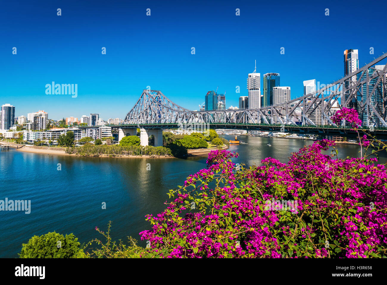 BRISBANE, AUS - AUGUST 9 2016: View of Brisbane Skyline with Story Bridge and the river. It is Australias third - Stock Image