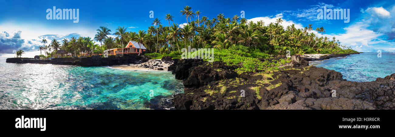 Panoramic view of coral reef and palm trees on south side of Upolu, Samoa Islands. - Stock Image
