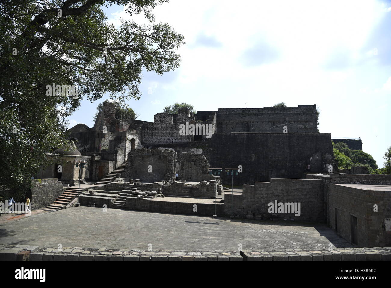 The historical architecture Kangra Fort is located 20 kilometers from the town of Dharamsala on the outskirts of  Kangra, India. Stock Photo