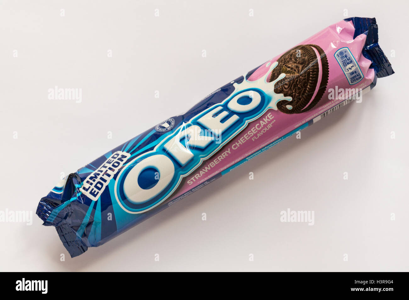 Packet of limited edition Strawberry Cheesecake flavour Oreo biscuits isolated on white background - Stock Image