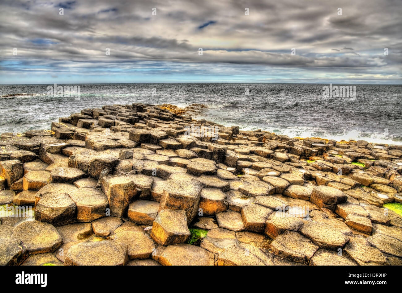 Basalt-tiled seashore of the Giant's Causeway - Northern Ireland - Stock Image