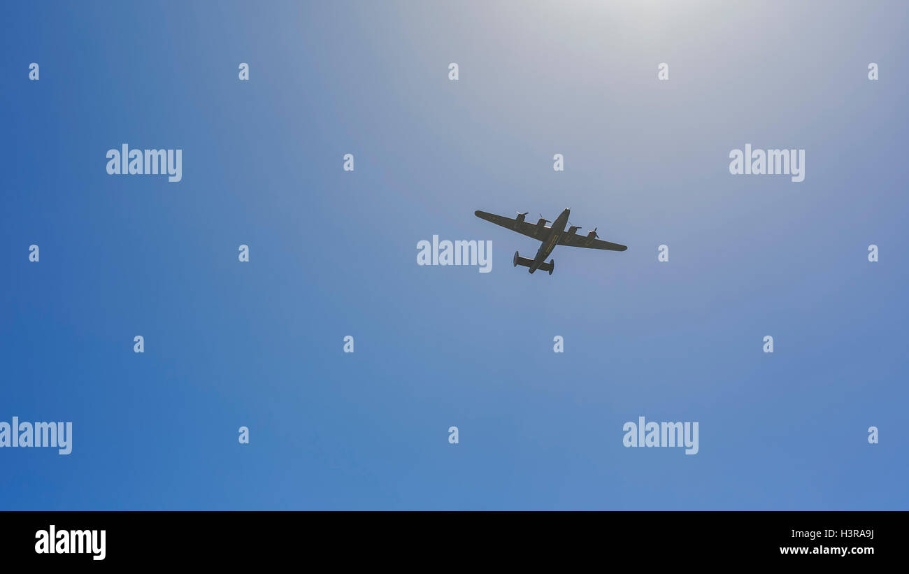 US Force airplane flying in sky, saw at The Flower Fields - Stock Image