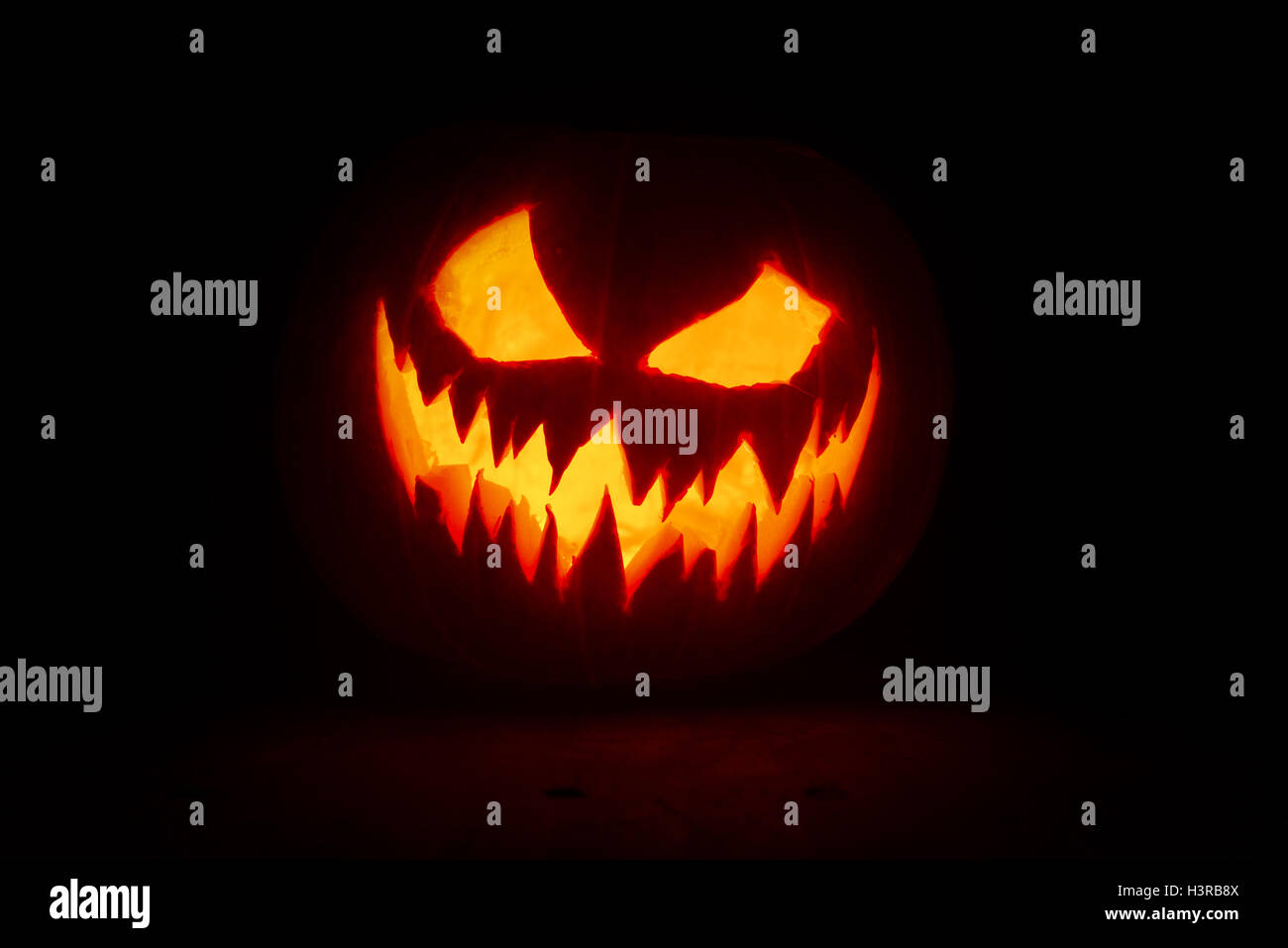 Halloween pumpkin's grin on black isolated background - Stock Image