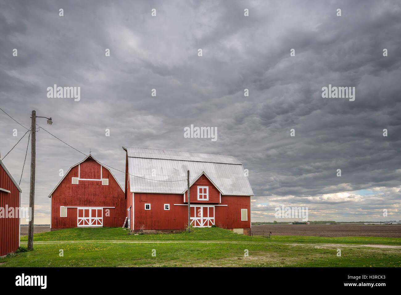 Bureau County,Illinois: Unusual double barn under a stormy sky - Stock Image