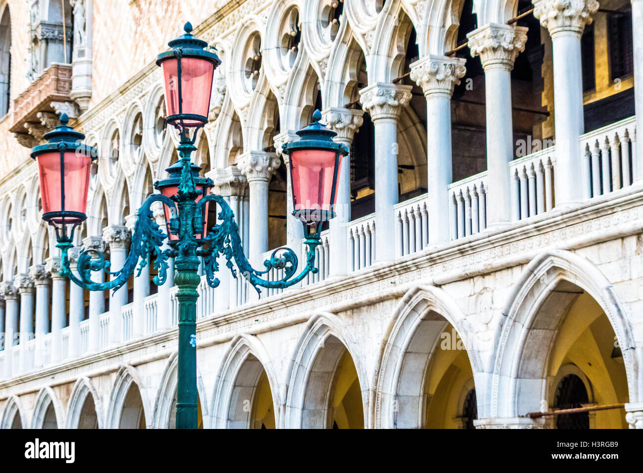 Lamp post with three unlit lights with Libreria Sansoviniana (Library) in background in Piazzetta Venice Italy Europe - Stock Image
