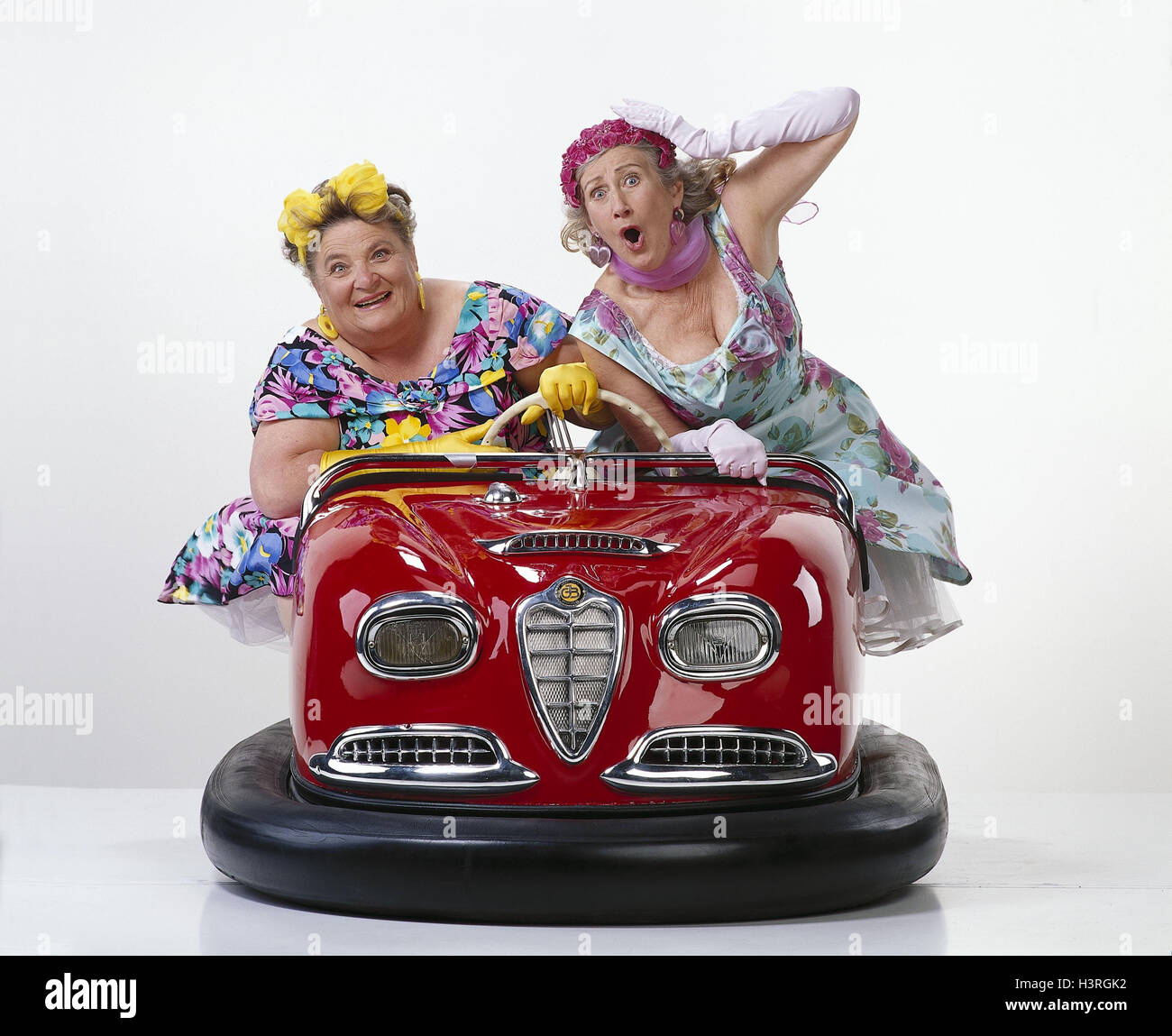 Women, two, middle old person, dodgem cars pleasure, amusement, melted, fun, Skooter, drive, studio, cut out Stock Photo