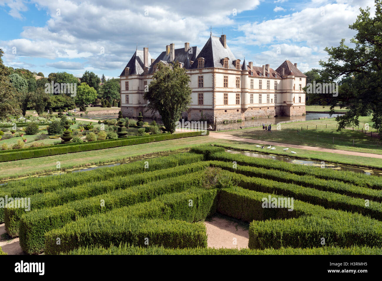 A view across the maze & the moat of the historic burgundian renaissance Chateau de Cormatin on a sunny Summer day Stock Photo