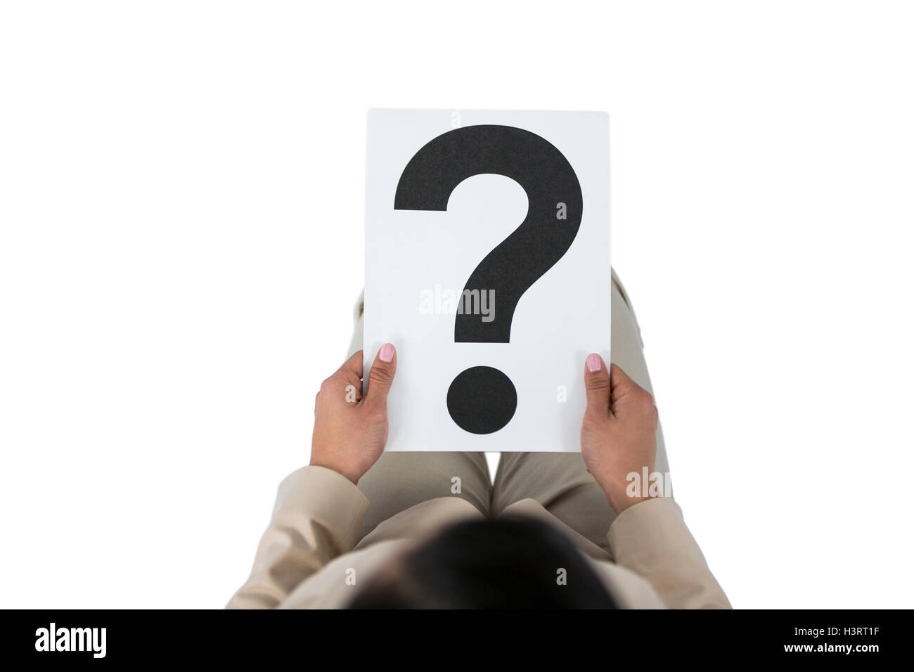 Businesswoman holding a question mark sign - Stock Image