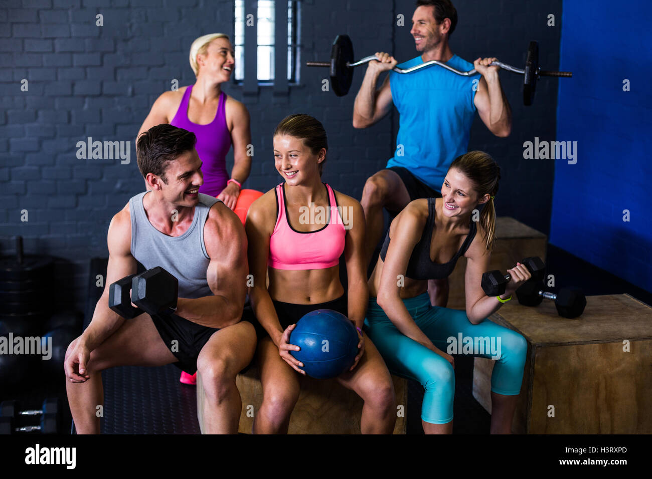 Happy athletes with exercise equipment - Stock Image
