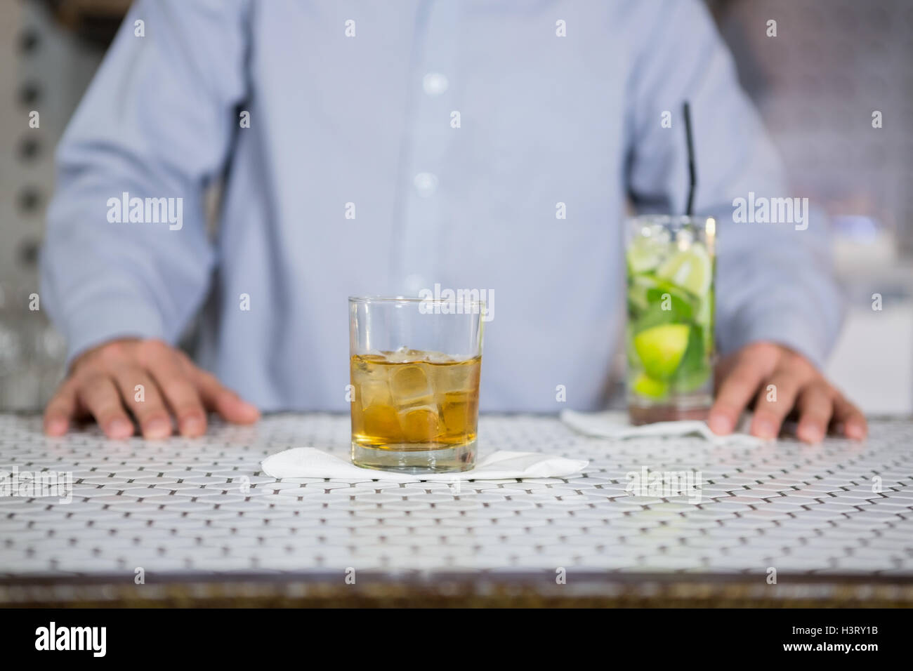 Glass of whisky on bar counter - Stock Image