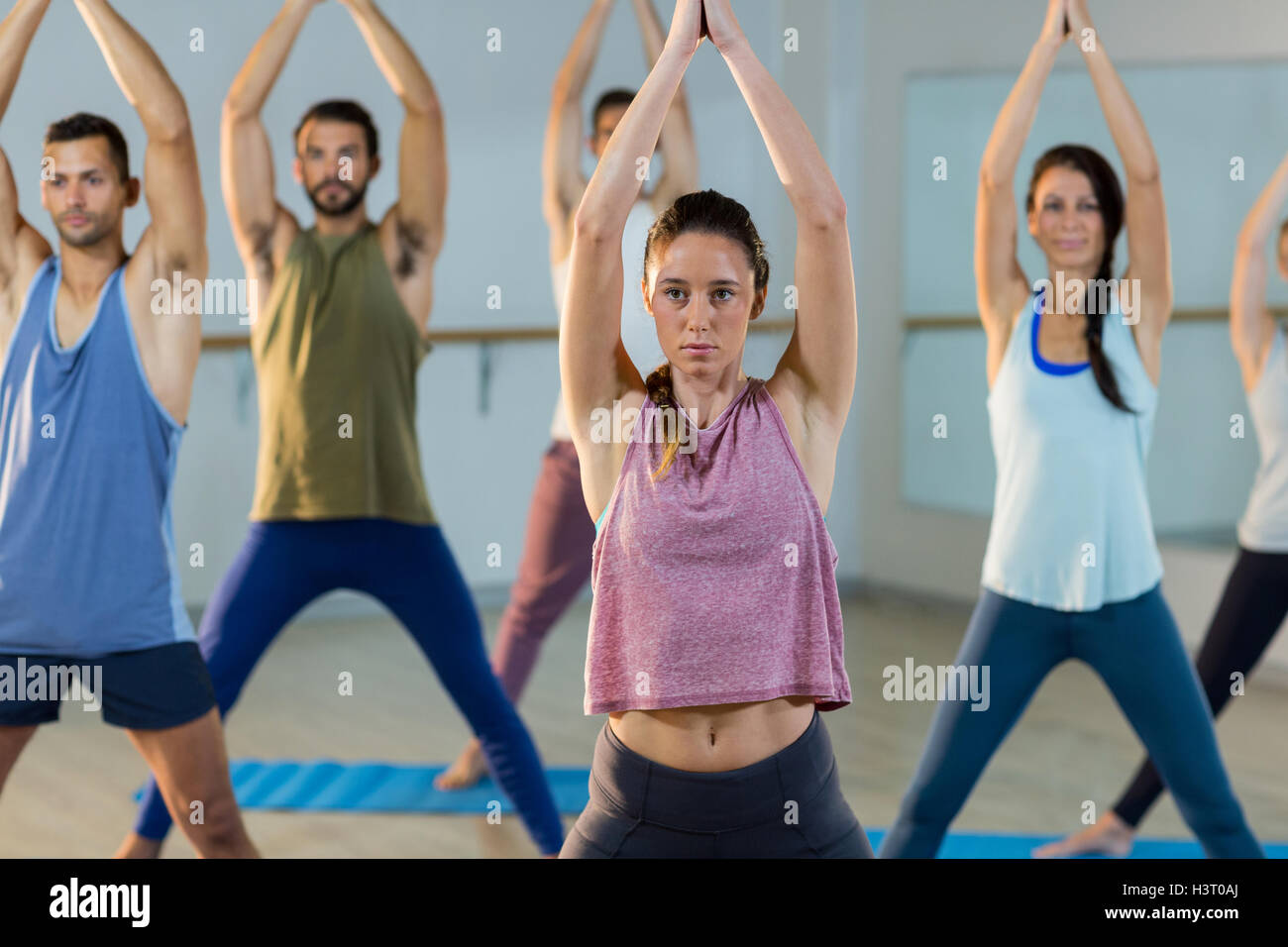 Instructor taking yoga class - Stock Image
