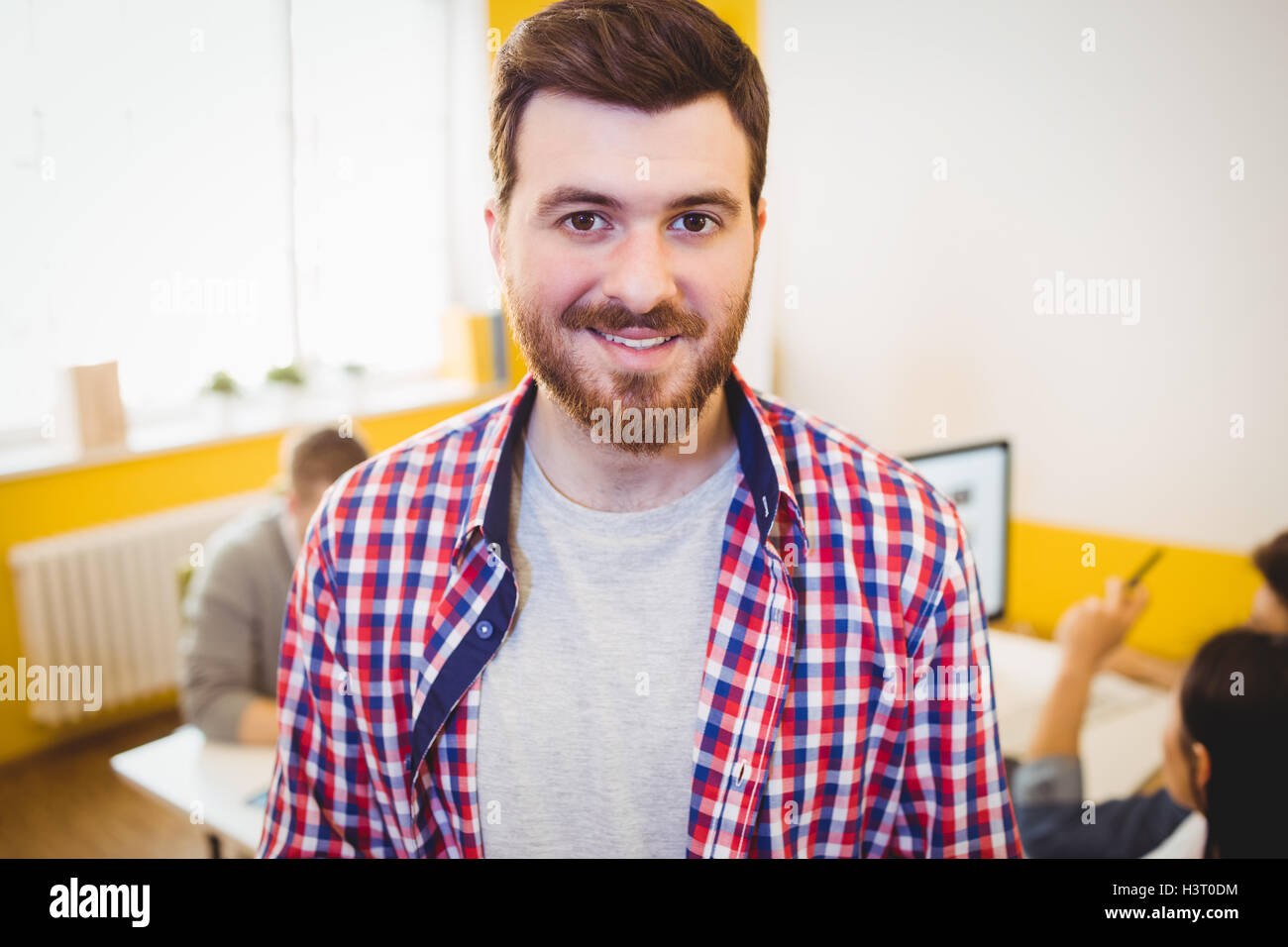 Portrait of happy executive at editing office - Stock Image