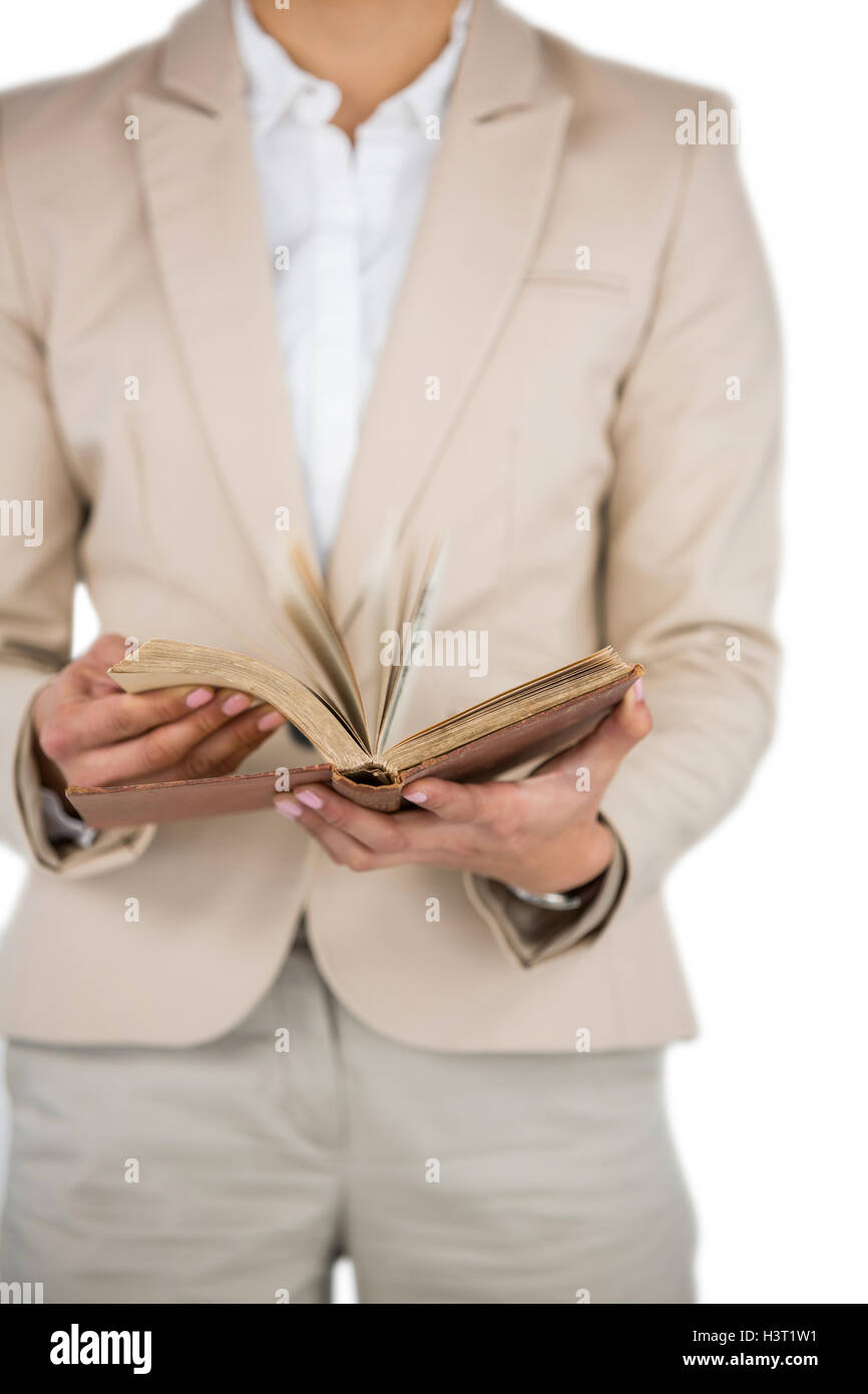 Mid section of Businesswoman flips through the pages of a book Stock Photo