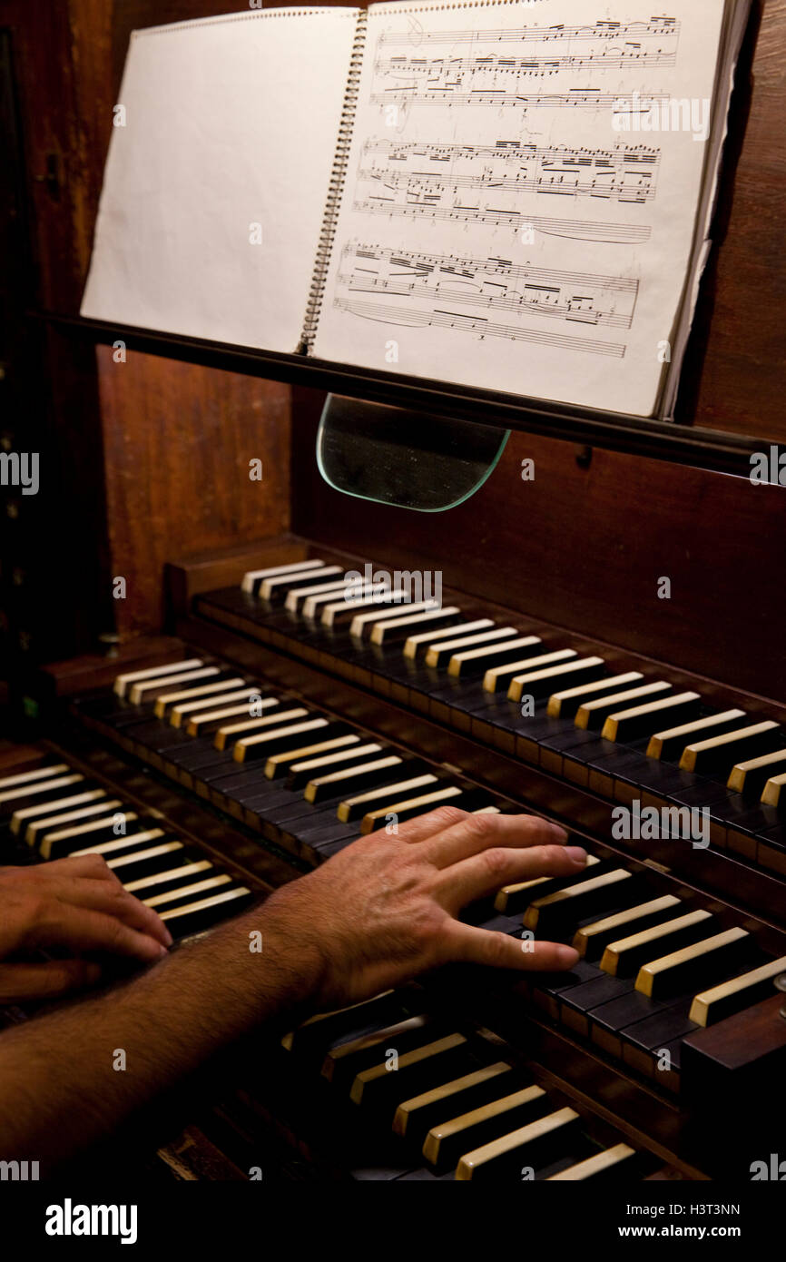 Organ player in action at the Mahon cathedral, Menorca, Spain. Stock Photo