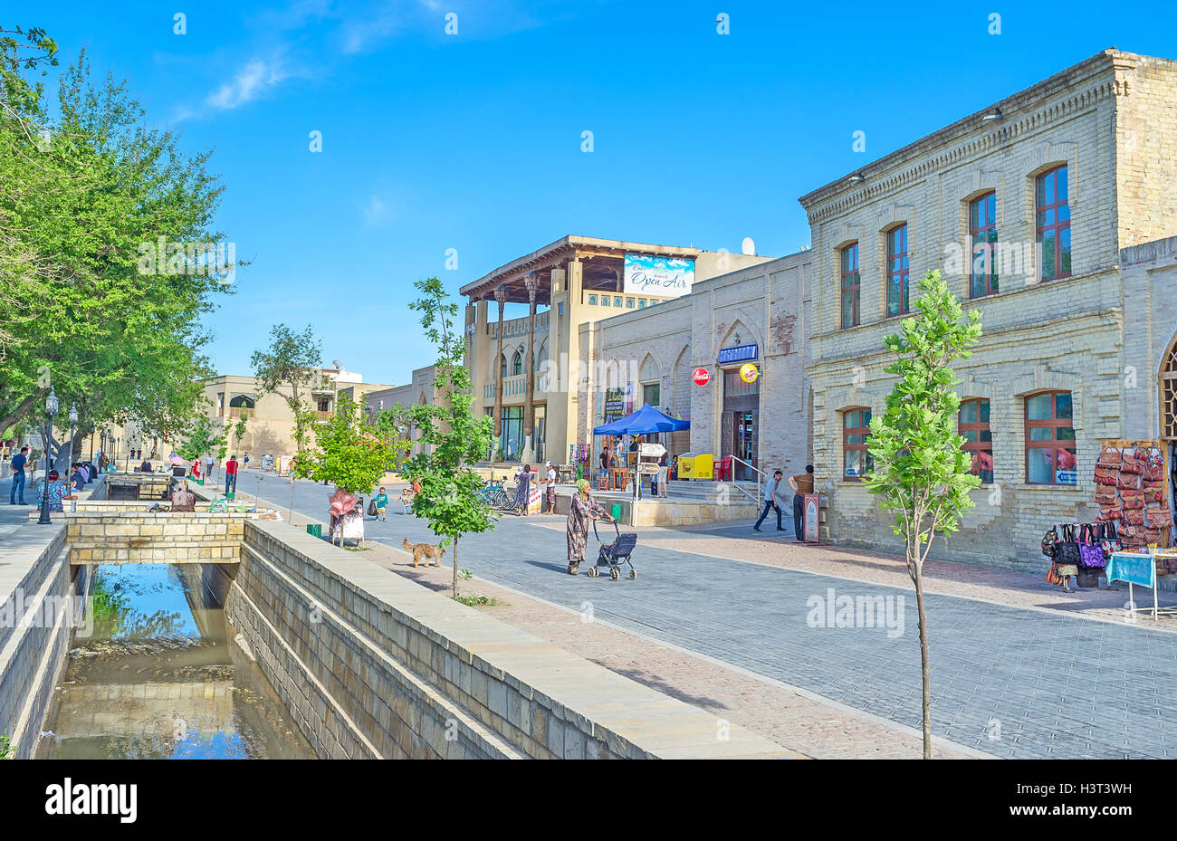 The street of Bakhowuddin Nakshbandi is one of the central tourist promenades in Bukhara. - Stock Image