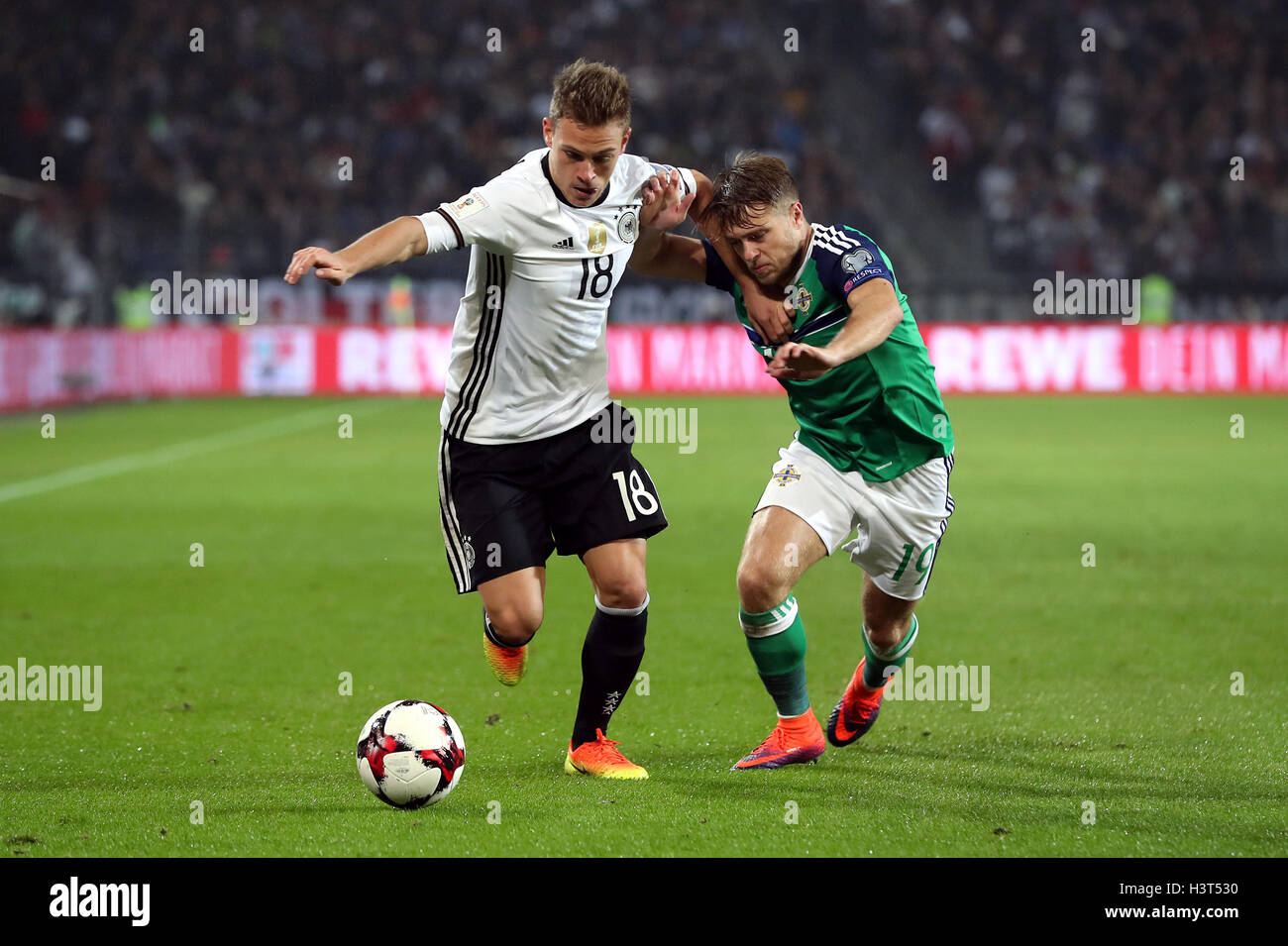 2758cf398a Germany s Joshua Kimmich (left) and Northern Ireland s Jamie Ward battle  for the ball during the 2018 FIFA World Cup Qualifying match at the HDI  Arena