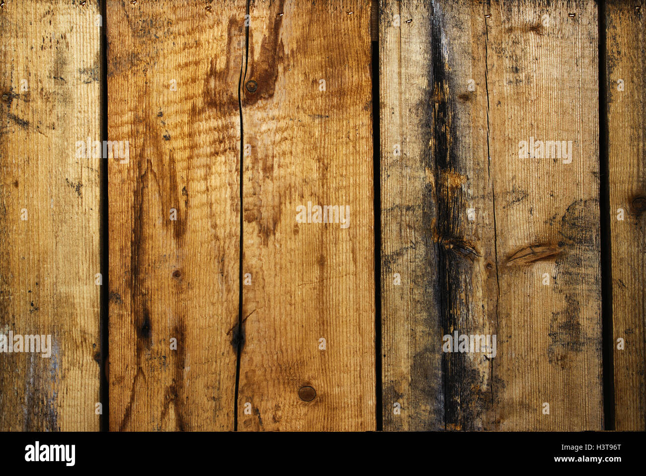 Rough wooden planks texture, old used weathered boards - Stock Image