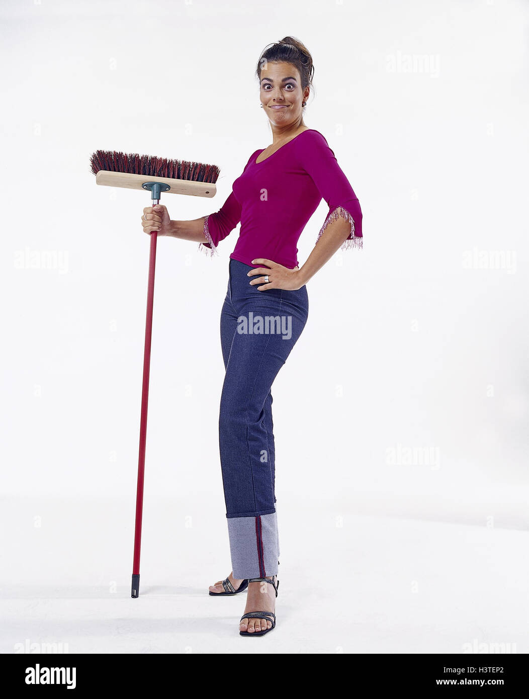 Woman, young, brooms, gesture, energetically, decided, grab women, housewife, vigorously, clean unerringly, determination, - Stock Image